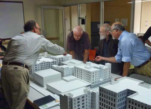 Rhoades, Gary Parsons, John English, and Kirk Peterson discuss the proposed addition atop the Ace Hardware store.