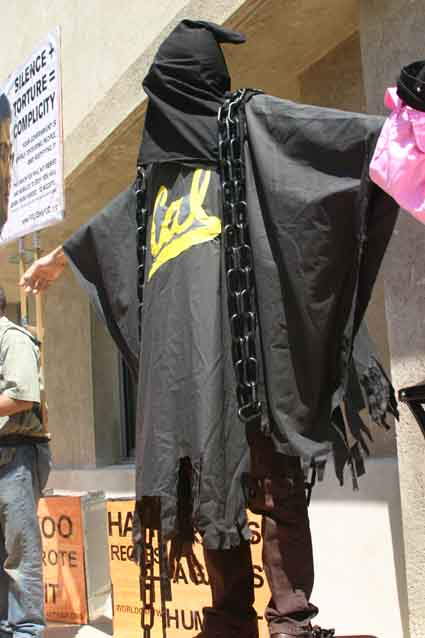 An anti-war activist dressed as an Abu Ghraib prison inmate during a protest staged  against Professor John Yoo outside the UC Berkeley Boalt Hall School of Law Monday.