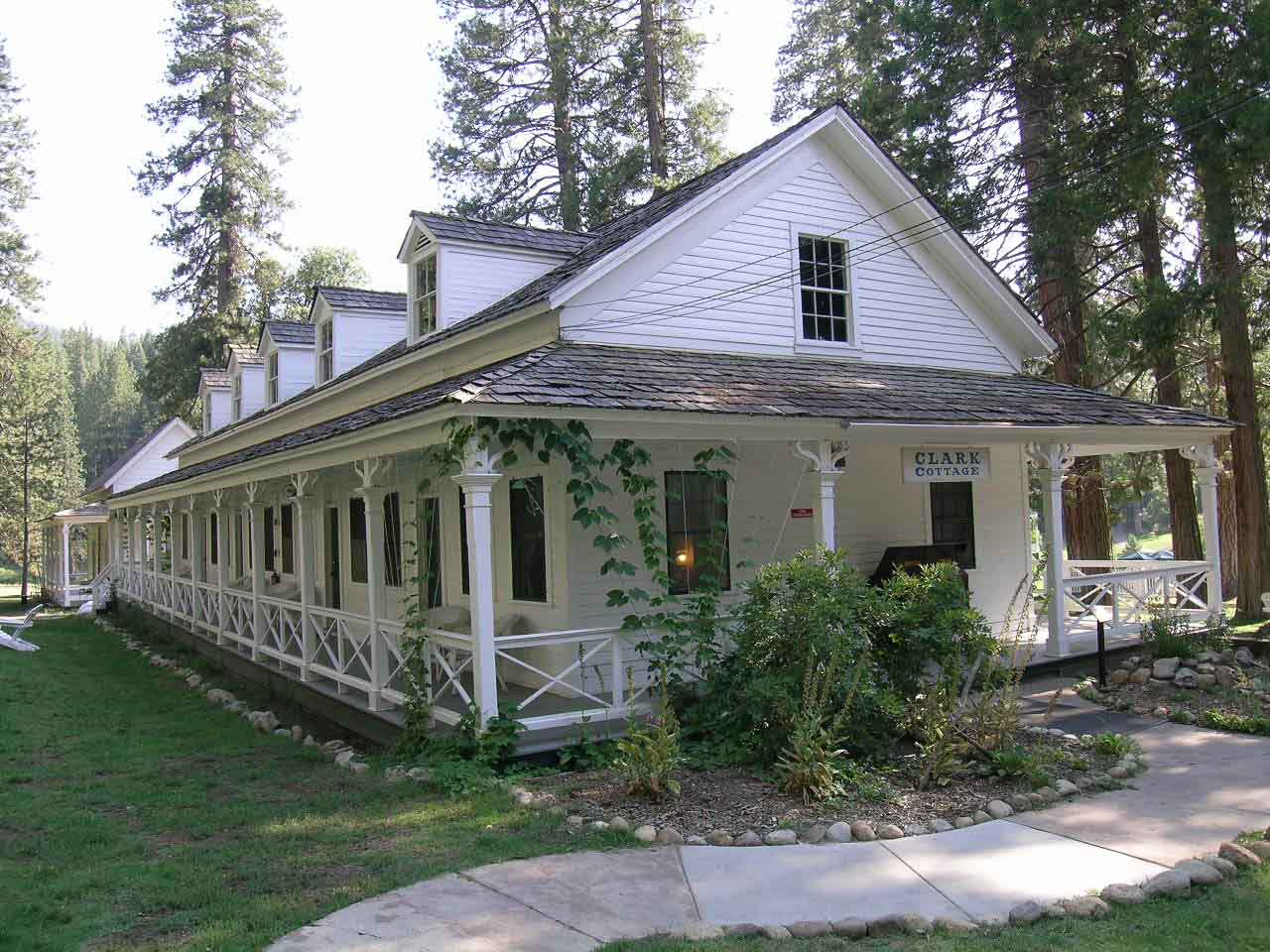 "Clark Cottage constructed in 1876, is the Wawona Hotel's oldest building. Originally ""Long White,"" it is now named after Galen Clark."