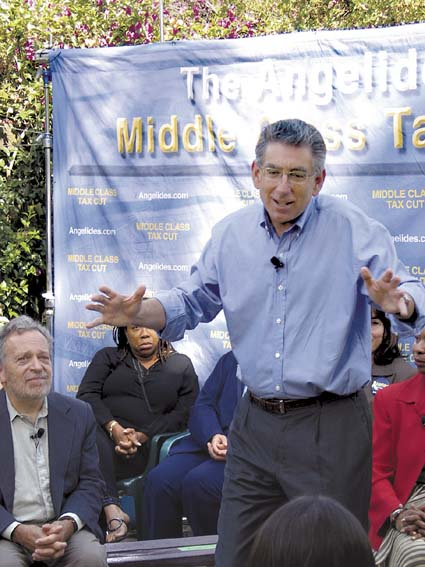 Standing between former Secretary of Labor Robert Reich and Rep. Barbara Lee (D-Berkeley-Oakland), gubernatorial candidate Phil Angelides speaks to an enthusiastic crowd in a South Berkeley backyard. Photograph by Judith Scherr.