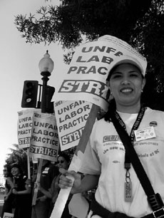 Catalina Estrada marches with 1,800 other UC Berkeley clerical workers who went on a three-day strike that started Monday.