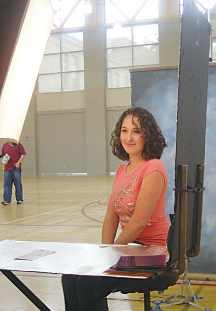 Berkeley High senior Giana Cirolia, 17, strikes a pose for her student ID card during registration Friday. Photograph by Riya Bhattacharjee.