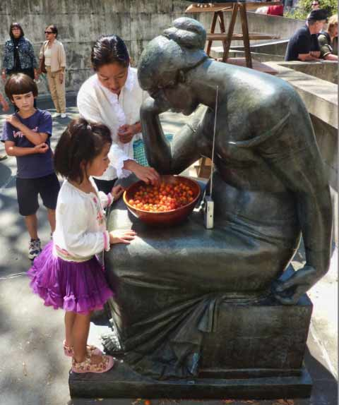 A Berkeley Art Museum sculpture does double duty as a stand for fresh tomatoes during the OPENeducation event on August 27.
