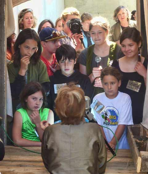 Alice Waters faces a group of children while being interviewed about the Chez Panisse 40th Anniversary.