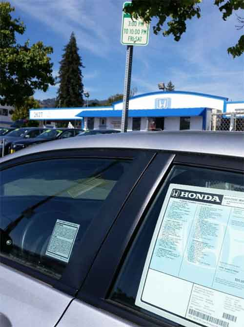 Also on June 20, 2015, Berkeley Honda was displaying new cars in 30-­minute parking spaces on Shattuck near Carleton.