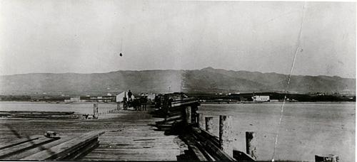 Captain James H. Jacobs' lumber pier, c. 1867.