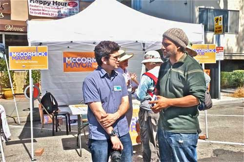 Berkeley politics at Solano Stroll Sunday. Kahlil Jacobs-Fantauzzi, right, with Josh Wolf, Jacquelyn McCormick's campaign manager, at her booth.  Three candidates are working amicably (though separately) to defeat 10-year Mayor Tom Bates in Berkeley's first ranked-choice mayoral race. City council veteran Kriss Worthington rounds out the list of leading Bates opponents. McCormick can be seen, center left, picking up a vote. Jacobs-Fantauzzi, a hip-hop performer, promoter and scholar hopes to get out the Berkeley youth vote.