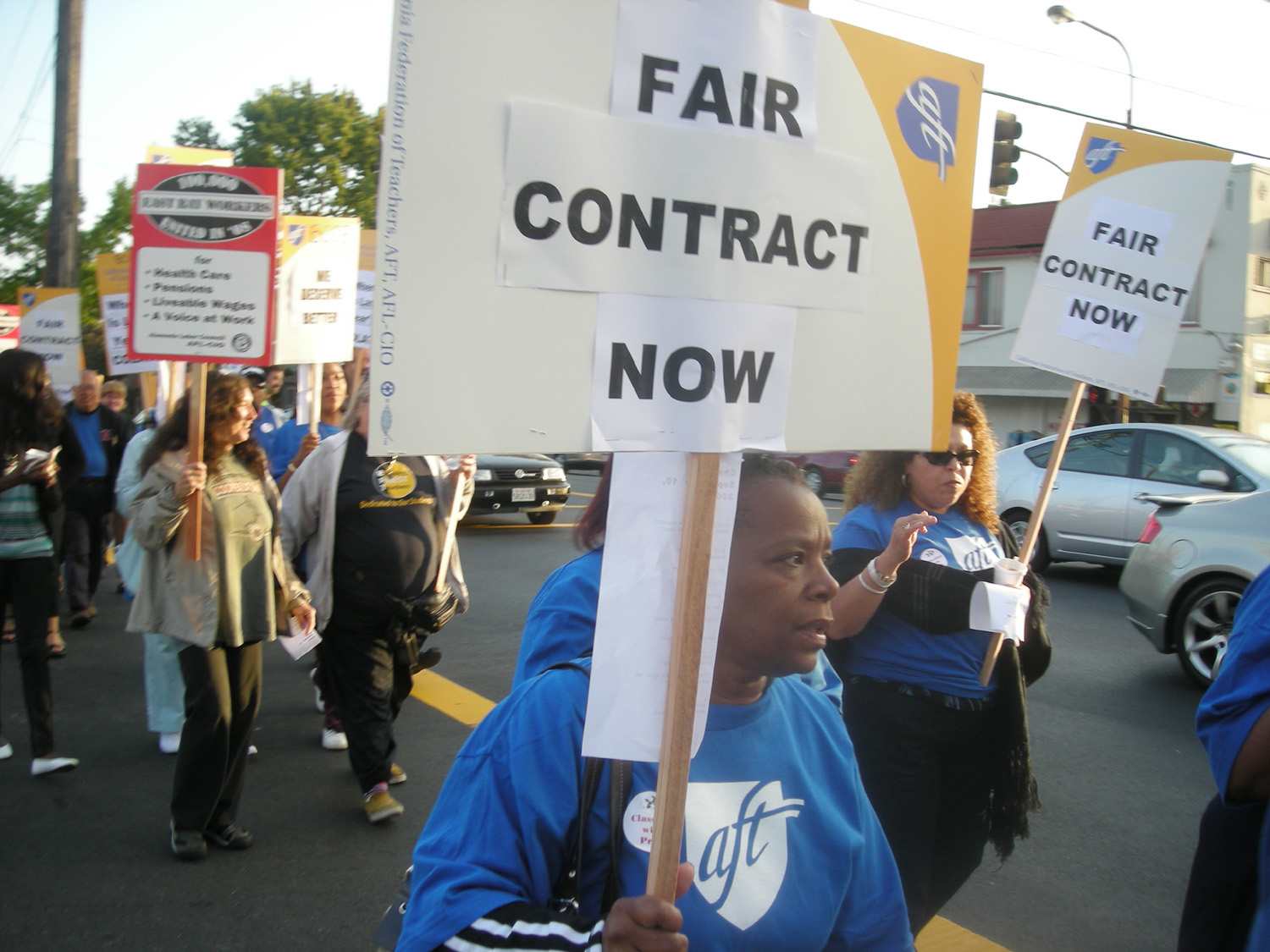Workers marched from Berkeley Technology Academy to school district headquarters Wednesday to demand contract renewals and pay raises.