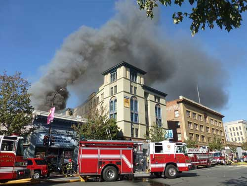 Smoke billows above Bachenheimer building