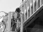 "A welder works on the new ""Milvia Buildings"" at Berkeley High School."