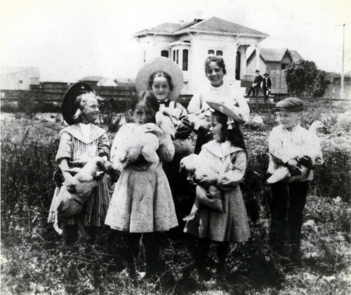 The Charles W. Heywood House, a landmark at 1808 Fifth St., was owned and occupied by the Young family when the neighbor's children posed for this photo about 1902.