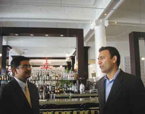 Hotel Shattuck Plaza owner Perry Patel inside the hotel's remodeled lobby and bar.