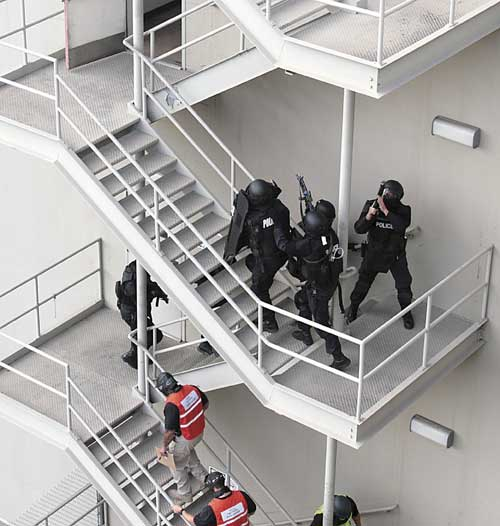 Members of the UC Berkeley police ascend the stairs of a former university laboratory on Berkeley Way as part of the Sept. 12 exercise that was part of Urban Shield, the largest Homeland 