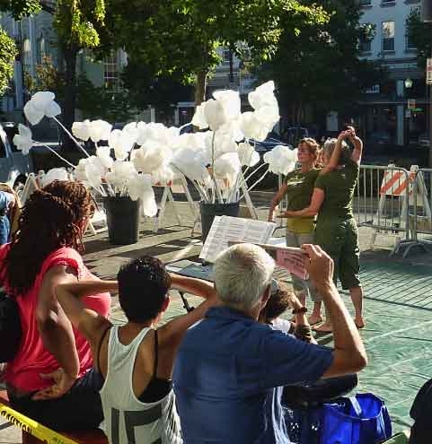 The Nina Haft & Company dance group organized a series of performances at Allston and Shattuck on Park(ing) Day, against a backdrop of recycled art.