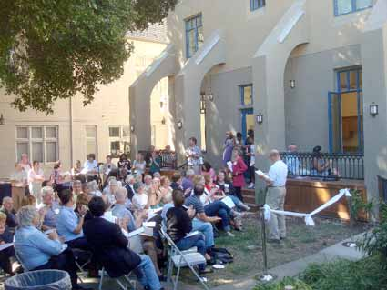 Some 75 people gathered for the dedication in the back courtyard, which
