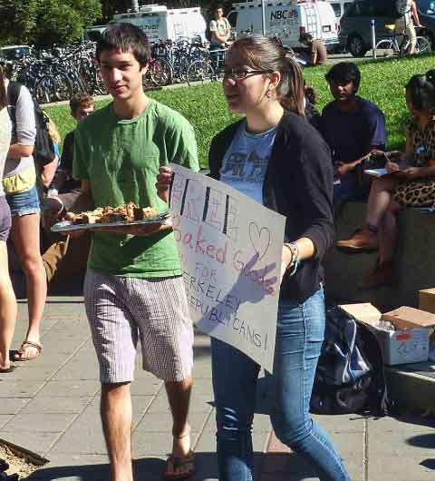 "Counter demonstrators offered ""Free Baked Goods, Even for Berkeley College Republicans""."