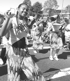 "How Berkeley can you be? Berkeley High student Ashay Serrant (left) was part of a group doing African dances during the ""How Berkeley Can You Be?"" parade on Sunday. See the story on page 3.Toby St. John/Special to the Daily Planet"