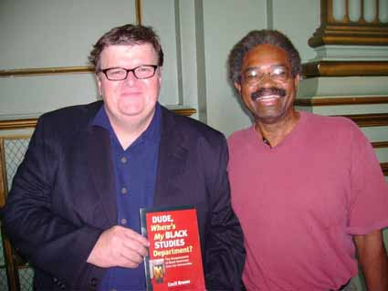 Michael Moore and Cecil Brown with the latter's book.