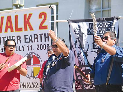 Native American activists, with Clarence Atwell of the Apache tribe at the microphone, rally for the return of ancestral remains at UC Berkeley on Friday. Photograph by Judith Scherr.