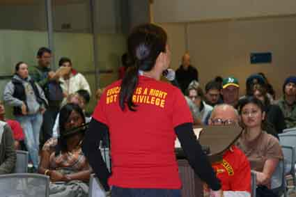 A Berkeley Community College classified employee speaks out against state budget cuts at Thursday's meeting in the BCC atrium.