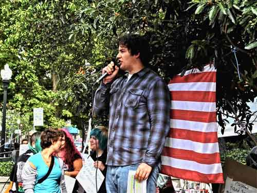 John, a facilitator, gives rousing call to action Saturday before Occupy Berkeley marches to Civic Center Park