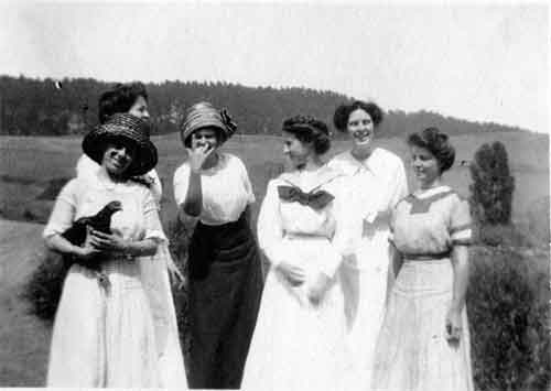 Six women clown and pose for a photo in the Berkeley Hills, probably around Spruce Street near Regal Road, around the time that the neighborhood began to develop.