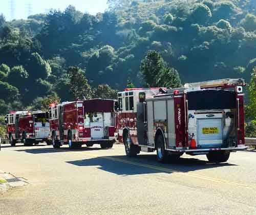 A ceremony marking the 20th anniversary of the Berkeley Hills firestorm ended with a procession of fire engines from several jurisdictions.