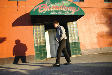 Jakob Schiller: A man walks by the long defunct Broadway club, one of the many boarded-up businesses in the Jack London Square district of Oakland..