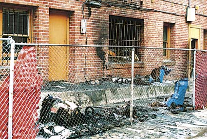 An arson fire early Sunday morning at 2445 Dwight Way, at the rear of the Reprint Mint on Telegraph Avenue, caused an estimated $25,000 in structural damage and another $20,000 in damage to the building's contents. Phtograph by Doug Buckwald.