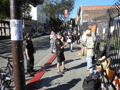 Musician Carol Denney is cited Sunday at Telegraph/Haste, for obstructing walk.
