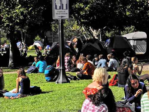 Berkeley High students at lunch-time near MLK Park. Southeast tent encampment, a troubled annex to Occupy Berkeley seems to loom over them; the city manager's office might be concerned
