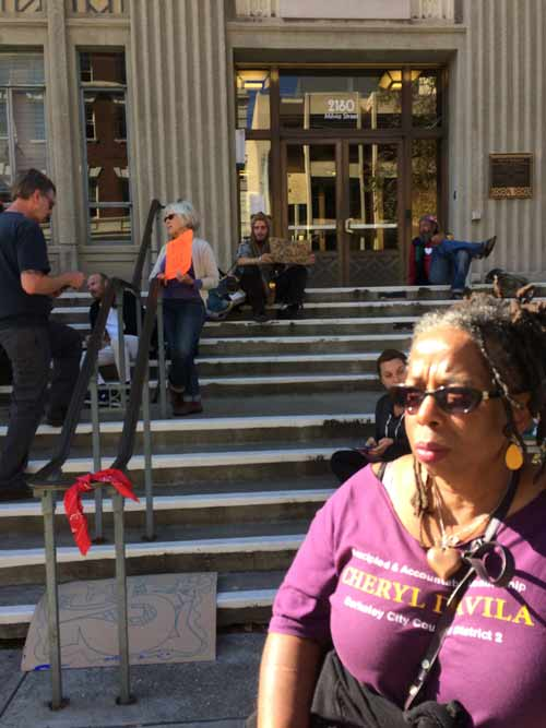 Cheryl Davila joined the growing protest over the latest eviction of homeless people on the steps of City Hall on Friday afternoon.