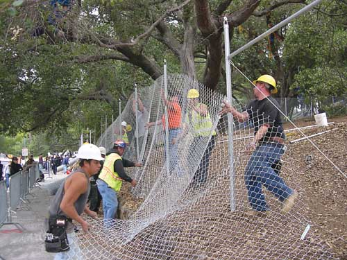 Workers construct the enlarged fence at the oak grove at UC Berkeley's Memorial Stadium Thursday. by Doug Buckwald