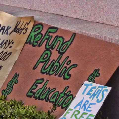 """ReFund Public Education"" next to ""Tents Are Free""."