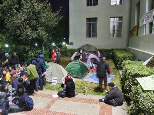 Tents, to right of Sproul Hall entrance in Sproul Plaza, U.C., are what's left of a larger encampment which was raided earlier today. The tents and the banners on Spruoul Hall, to right, are in violation of UCB restrictions, according to a UCPD spokesman. Later there was a clash with police.