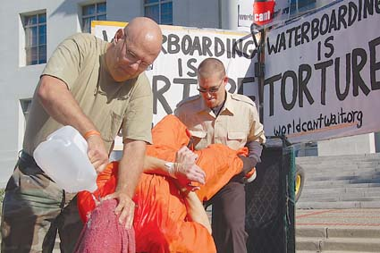 Iraq war vet Joe Tugas undergoes a waterboarding demonstration at Sproul Plaza Wednesday as part of a rally to protest the nomination of Judge Michael Mukasey as U.S. Attorney General. Photograph by Felix Barrett.