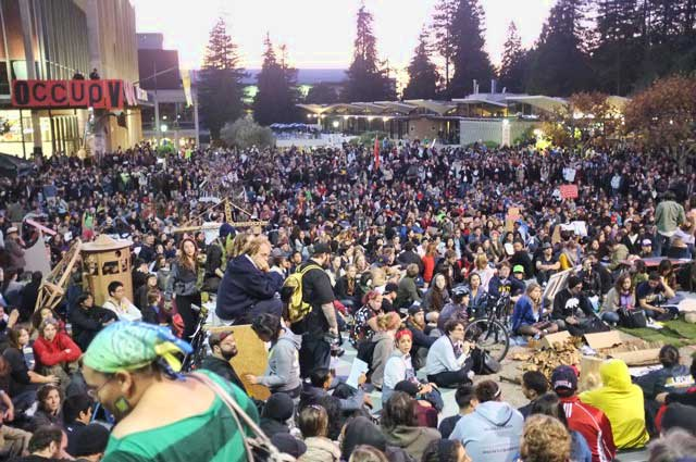 General assembly, 2,000 strong, debates whether to flout university directives, Tuesday night.