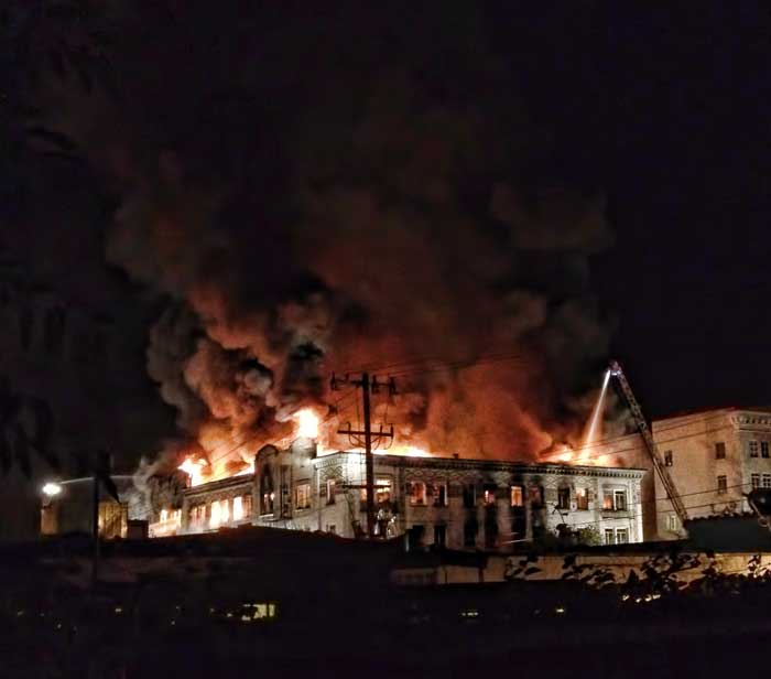 At 1 a.m. flames were still visible from the roof of the Sequoia Apartments on Telegraph at Haste.
