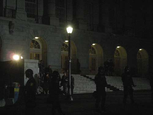 Police escort student occupiers outside Wheeler Hall around 9 p.m.