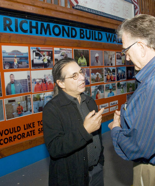 Newly elected Richmond Councilman Jeff Ritterman talks with a constituent during a program held at the city's RichmondWORKS program.
