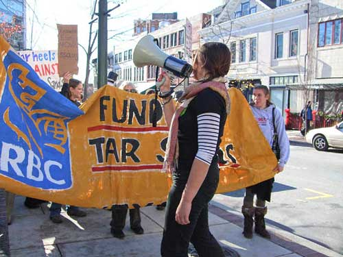 Demonstrators in Asheville, NC, protest the Royal Bank of Canada's investments in tar sands and the Keystone XL pipeline. Six of the demonstrators were arrested at the Bank of America, one of the targets of the demonstration.