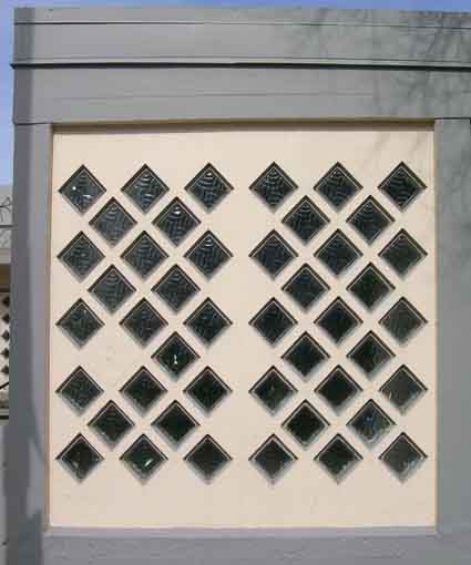 A detail of two grid-form wall panels.