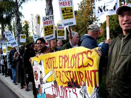Union members demonstrate outside the Claremont Hotel Monday.