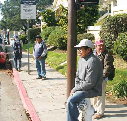 Day laborers wait for work at Hearst Avenue and Fifth Street Wednesday afternoon.