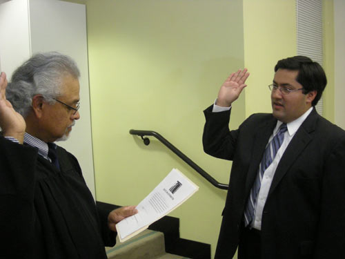 Federico Chavez, administrative law judge, swears in Jesse Arreguin as the new councilmember for District 4 at Berkeley City Hall last Wednesday. Arreguin, who took office on Nov. 27, became the city's first Latino councilmember and the youngest elected official on the City Council.