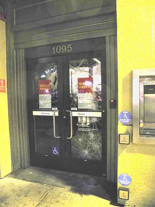 Protesters smashed the doors of a Wells Fargo office in a commercial/residential building at San Pablo and University.