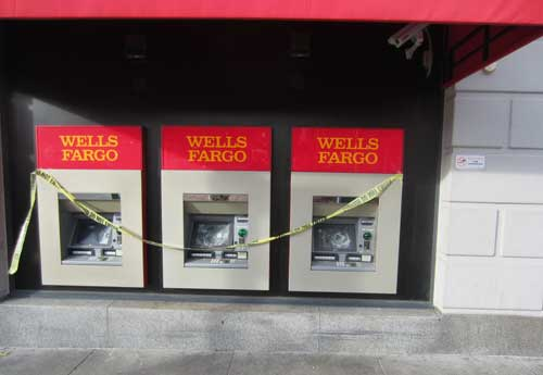 Screens on the ATMs at the Wells Fargo bank on Shattuck were damaged.