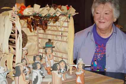 Judy Davis, above, overlooks a 35-piece nativity scene created by Ester Cajero of the Jemez Pueblo in New Mexico, one of her 250 crèches on display at St. Clement's Episcopal Church this weekend.