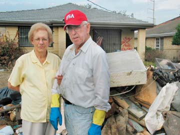 Sarah Core: Margarite and Huey Borne in front of their ruined home in Chalmette, La.