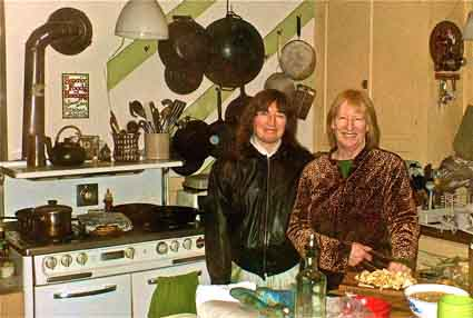 Kathy and Val in the kitchen of Brigid House on 10th Street.